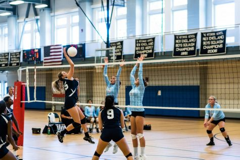 Harper Pertchik '20 spikes the volleball during a game.