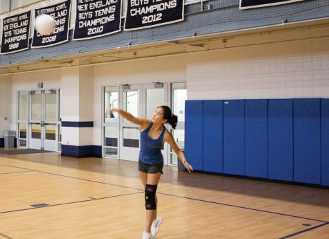Rena Peng '22 serves the ball during practice.