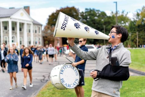 Daniel Pai '19 and Jack Kempczinski '20 cheer on walkers as they participate in the annual Crop Walk last Sunday.