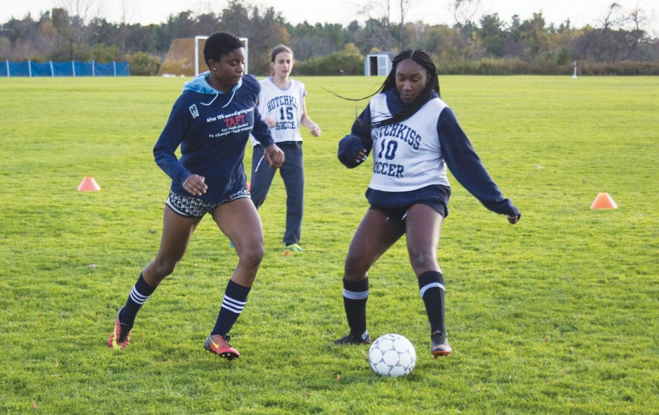 Deb Adeyemi '20 and Elaine Oghoore '22 fight for the ball during practice.