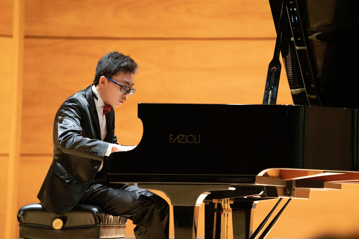 Ricky Shi '22 performs in Elfers Hall at the Instrumental Recital on Tuesday, November 6.