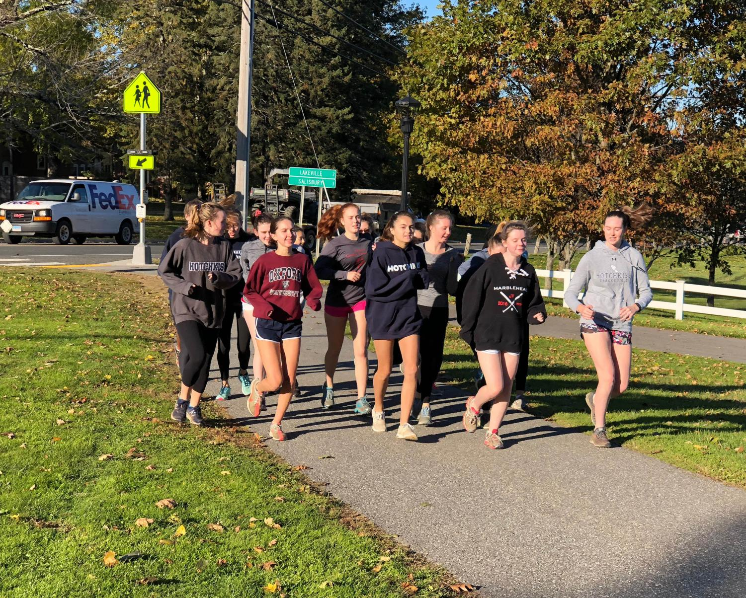 The Girl Cross Country team warms up.