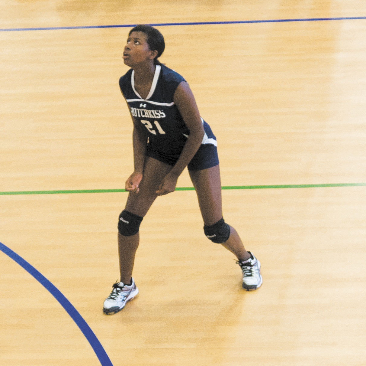 Nia Warren '19 prepares to dig the ball against Taft.