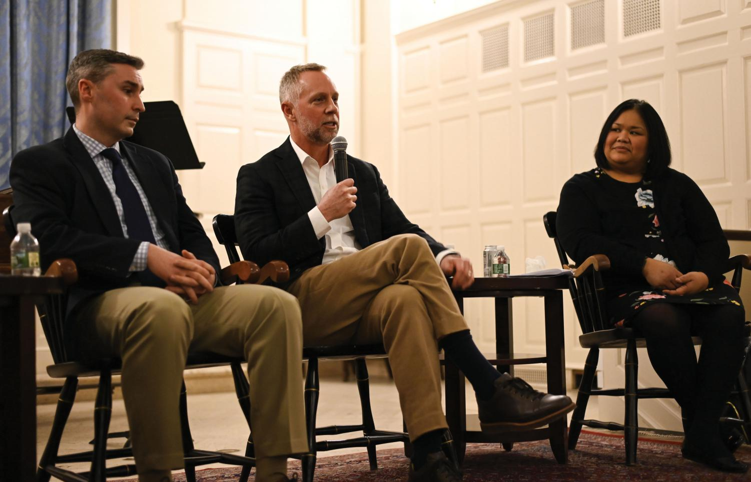 From left: Chris Doyle, director of admission at Marist College, Greg Roberts, dean of admission at the University of Virginia, and Peaches Valdes, dean of admission at Hamilton College, share tips with Upper Mids and their parents.