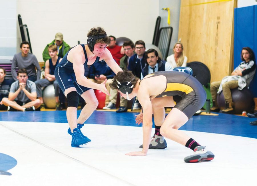 Nick Adams '19 grapples with an opponent.