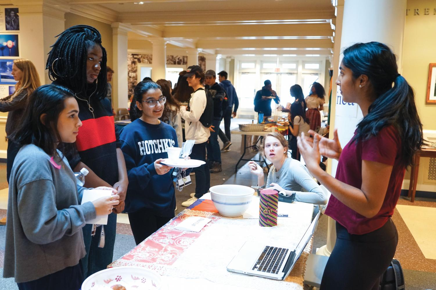 Alisa Ghura '19 presents Mauritian culture to Aritri Ghosh '19, Nneka Okoli '19, Priyanka Kumar '19, and Anne Seaman '20 at the Cultural Fair.