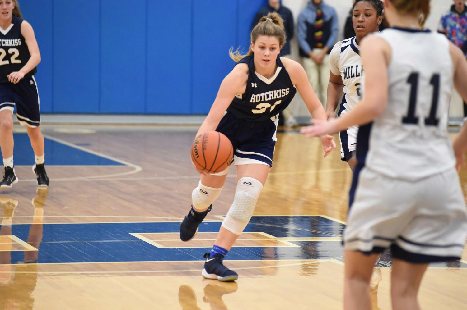Hattie Childs '19 dribbles the ball against Millbrook