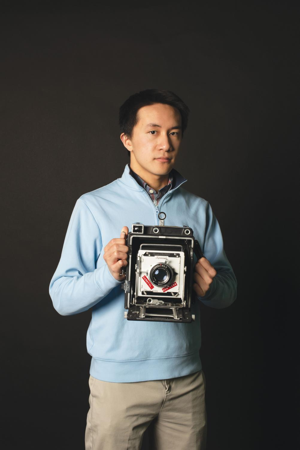 Edward Guo '19 holds a 4x5 film camera, which was first invented in the 19th century.