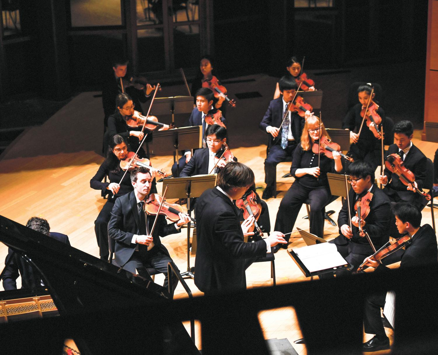 Fabio Witkowski conducts the Philharmonic Orchestra during its debut concert in Elfers Hall.