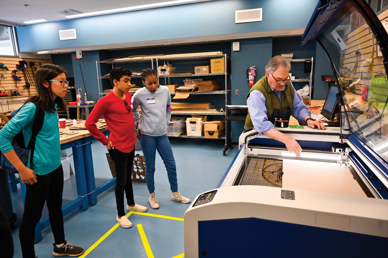Mr. Brad Faus, director of visual arts, demonstrates the laser cutter in the EFX Lab.