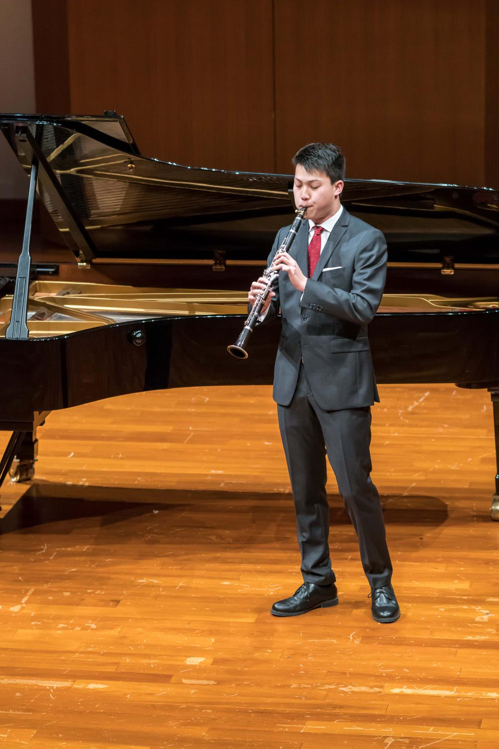 Matthew Yao '19 performs the clarinet at a reception in Hong Kong last year.