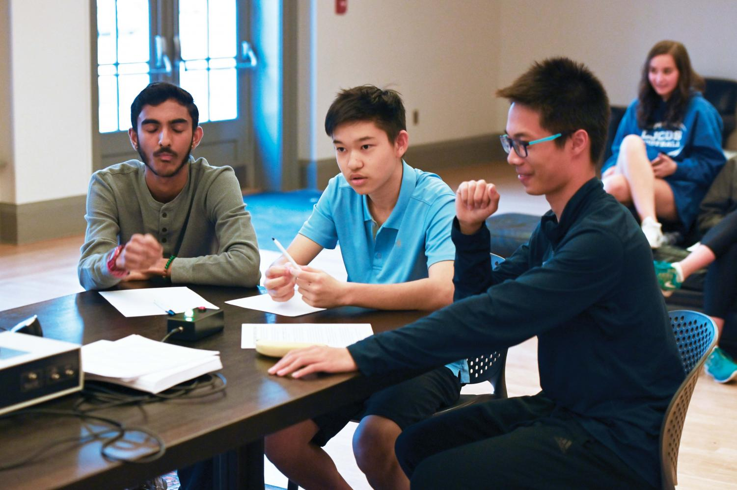 Felix Bao '21, Sachin Umashankar '21, and Andrew Yang '21 compete in a Bow Tie Bowl match last Thursday.