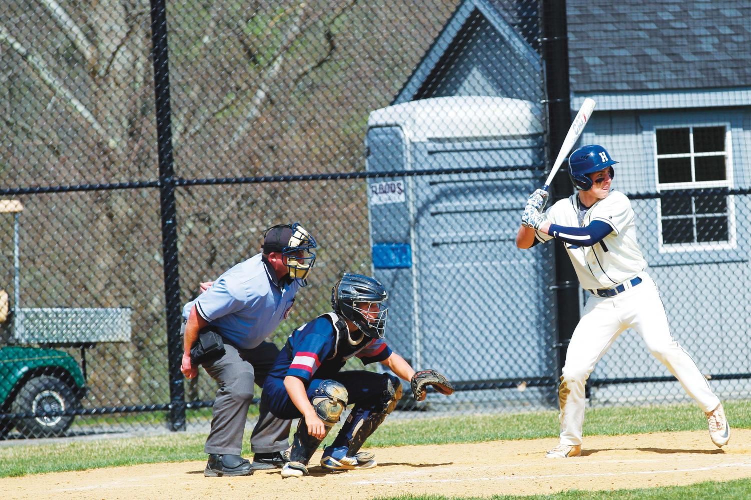 Tommy Lewis '19 anticipates a pitch in a game against Kent on May 1.