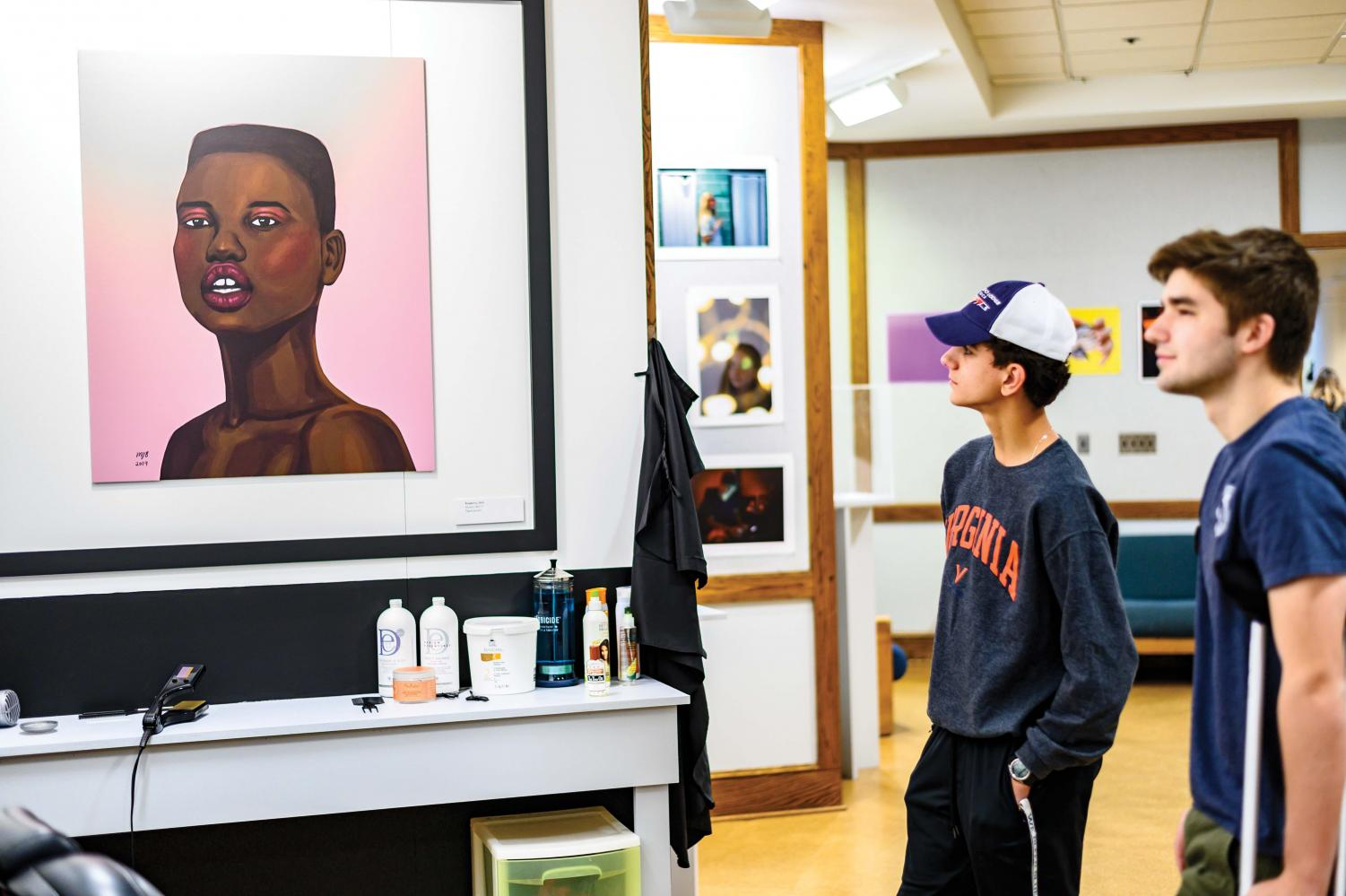 Peter Kallos '22 views Raspberry by Mariah J. Beil '17 in the Black History Month Exhibit.
