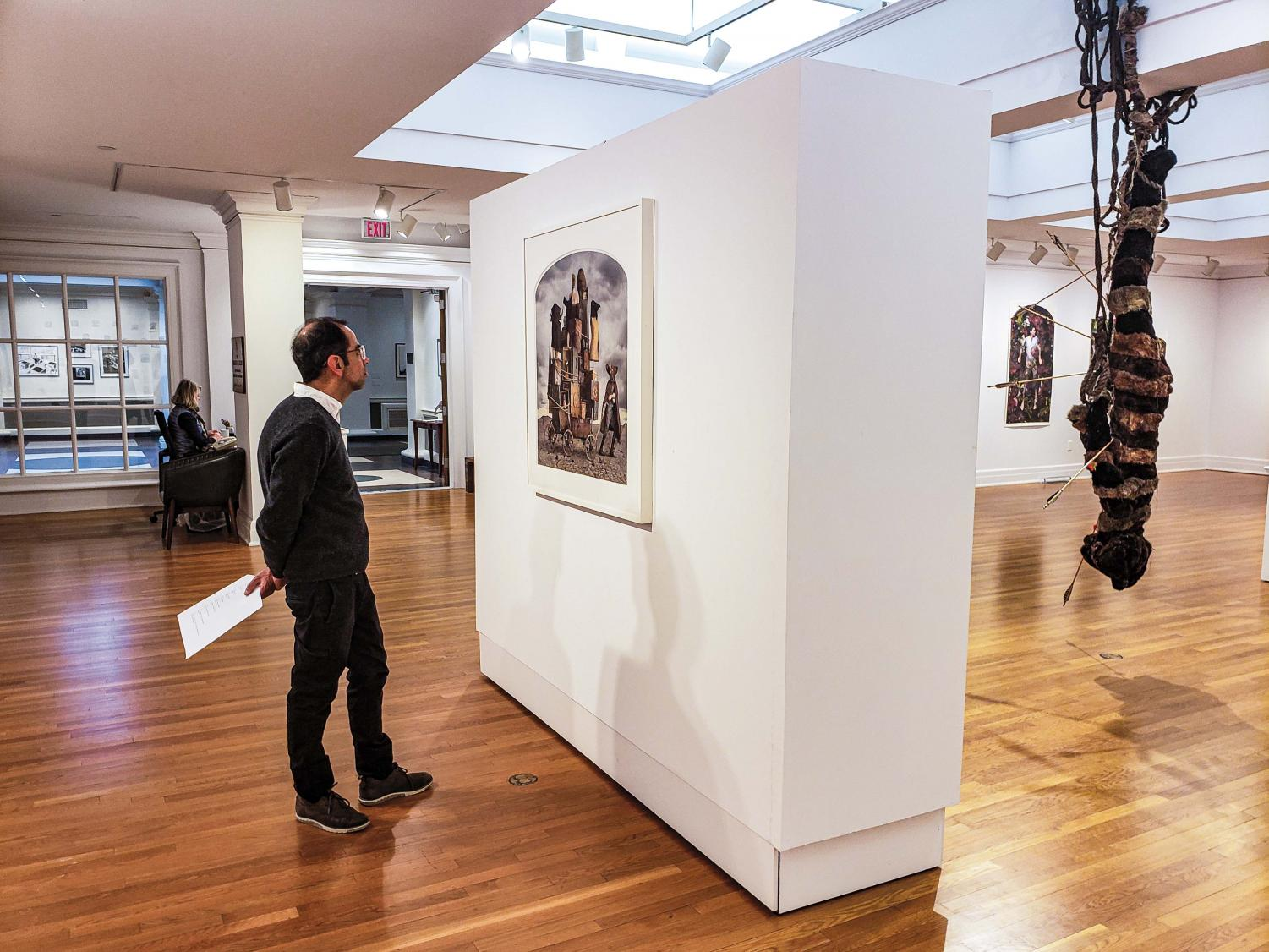 Francisco Barrios, Instructor in Spanish, takes in a scene from the gallery's newest exhibit.