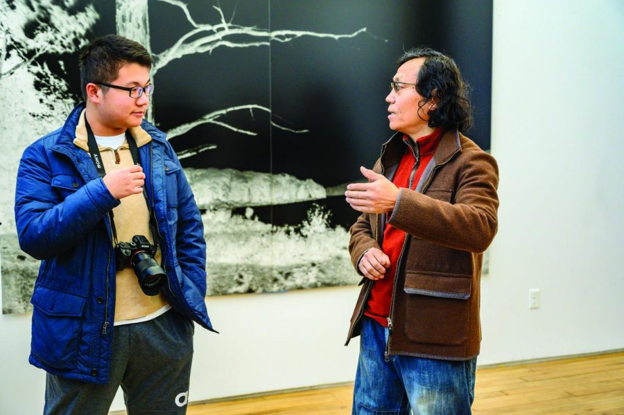 Jerry+Sheng+%E2%80%9920+translates+for+Shi+Guorui+as+he+introduces+his+works.