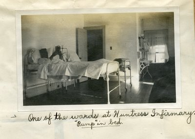 A ward bed in the Huntress Infirmary, in 1908, taken by Raymond Bowen, Class of 1908.  Credit: Raymond Bowen '08 Scrapbook, Hotchkiss Archives & Special Collections