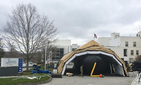 Members of the Connecticut militia set up a temporary field hospital in the Sharon Hospital parking lot for recovering COVID-19 patients this past Friday.