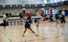 The Girls Varsity Volleyball team, depicted above in a match last year, has adapted to pandemic restrictions this year by focusing on technical skills.