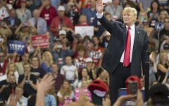 President Trump waves to the crowd at a rally.