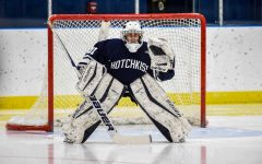 Hatch plays goalie for Girls Varsity Hockey in a game during last year's season.