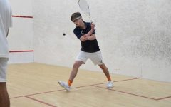 Clayton's favorite part of playing squash is its balance of competition and sportsmanship.