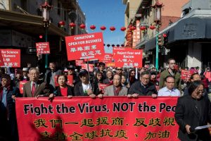 Chinatown residents along with local and state officials protest against racism against the Chinese community during a march in San Francisco on February 29.
