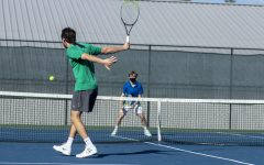 Beckwith hits a backhand on the courts this spring.