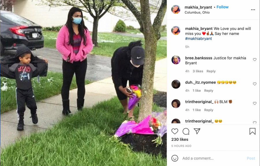 Mourners leave flowers in a post from Bryant
