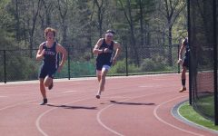 Bodie Molnar '21 running during a track meet.