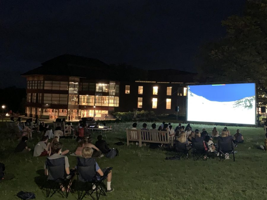 Students watch finalist films in front of Harris House