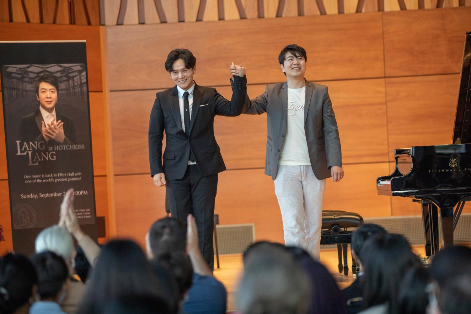 The crowd applauds after Chen and Langs performance.