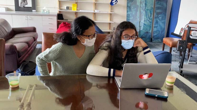 Darina Huang 23 and Nithya Chundi 23 work together in the Multicultural Center.
